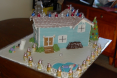 Blue Farmhouse Gingerbread House by Reah Lamfers