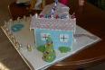 Blue Farmhouse Gingerbread House by Reah Lamfers