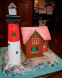 Gingerbread Lighthouse with Rocky Shoreline (also lights up) by Christa Savery Dunn